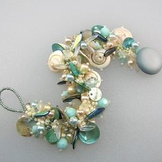 sand and sea freeform bracelet with lots of shells & pearls