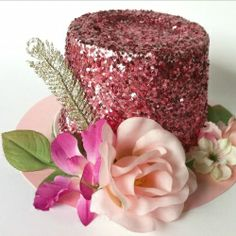 Just in time for Mother's Day, recycle a sour cream or cottage cheese container into a sparkly hat-shaped gift box.