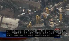 Search-and-rescue workers look through a mountain of debris at an elementary school in Moore, Okla., that was completely destroyed by the tornado that ripped through Oklahoma City.