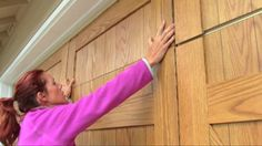 14.  Pull each upper panel down to where it aligns with the bottom of the top garage door panel.  Then snug all panels below it up to it.  This will ensure maximum clearance when you raise and lower your garage door.