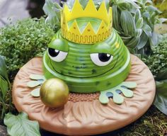 frog prince in the garden made of terracotta bowl