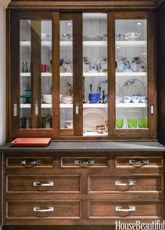 Designed with sliding glass doors, this cabinet was inspired by a traditional butler's pantry. The recessed top allowed Peacock to add a Caesarstone counter.   - HouseBeautiful.com