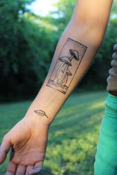 Super earthy temporary tattoo ~ Three tall growing mushrooms framed in a rectangle. Love fungi tattoos!