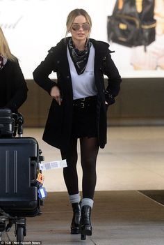 Flawless arrival: Margot Robbie looked gorgeous and fresh as she stepped off her long-haul...