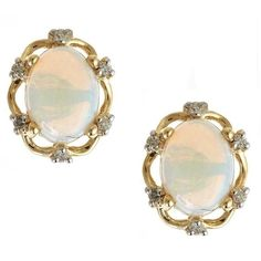 Anika and August 10k Gold Oval-cut Australian Opal and Diamond Accent earrings