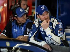 NASCAR Sprint Cup Series driver Dale Earnhardt Jr., right, talks with a crewman, left, in the garage prior to practice on Thursday, May 21, 2015 at Charlotte Motor Speedway in Concord, NC.