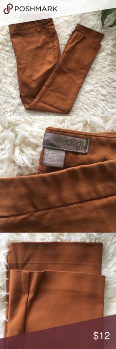 Forever 21 Cropped/Ankle Pants Size: Small   Color: orange/ copper/ terracotta   55%Cotton/41%Nylon/ 4% Spandex  Approx. 34 inches in length   Please review photos carefully. Left leg needs to be rehemmed. Forever 21 Pants Ankle & Cropped
