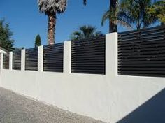 Rendered block and metal slat fence