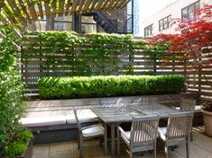 Raised planter bed bench - used grid fence idea with climbers or shrubs outside for privacy - TANK 2012 Client photographs - traditional - Patio - New York - Lynn Gaffney Architect, PLLC
