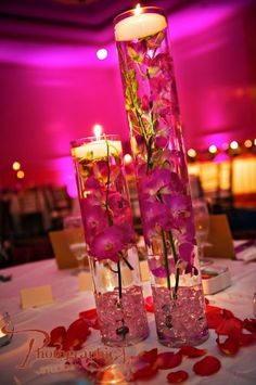candle in a glass with pink flowers