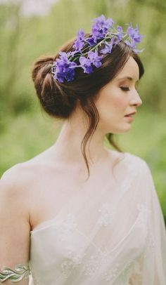 Gorgeous loose low updo wedding hairstyle with purple flower crown; Featured Photographer: Paul O'Hara