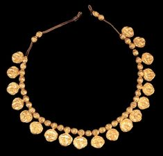 Etruscan Gold Necklace with Mask Pendants, 4th Century BCThese mask faces are possibly representations of Dionysus.