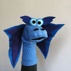 felt dragon Klaus is a strong, fire breathing Dragon Sockett. Sometimes he pals around with his friends and other times he takes off in solitary sock puppet flight, his vibrant felt wings Dragon Love, Felt Dragon, Blue Dragon, Sock Puppets, Hand Puppets, Crafts To Make, Crafts For Kids, Famous Shop, Fire Breathing Dragon