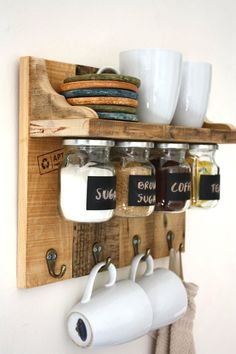 Gorgeous spices or coffee shelf with hanging jars which have chalkboard labels and hooks to hang towels, cups etc. - http://centophobe.com/gorgeous-spices-or-coffee-shelf-with-hanging-jars-which-have-chalkboard-labels-and-hooks-to-hang-towels-cups-etc-5/ -
