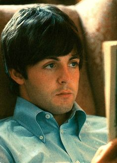 Paul McCartney reading a paperback. I love the high button down collar on his shirt. I wish more labels made them like this.