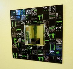 Monster Energy drink cans turned mirror tiles. just saw this concept on HGTV using bunch of different soda cans.  they hung it on the homeowner's patio. great conversation piece! and great way to turn that addiction into cash ~ looks like fun! gonna do for my son's room
