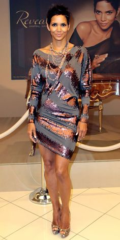 Halle Berry  Berry launched her Reveal fragrance in Hamburg, Germany in a Mark + James by Badgley Mischka dolman minidress accented with Irit Design necklaces.