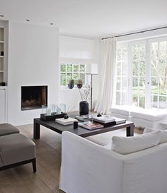 Modern white interior and fireplace