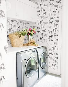 A laundry-cum-mud room with a bold wallpaper print {PHOTO: Tracey Ayton}