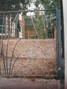 wrought iron gate with flowing lines http://lizplummer.com