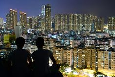 Silhouette of 2 Person on Top of the Building during Nighttime  Free Stock Photo