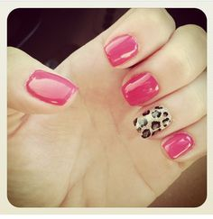 Coral polish with leopard accent nail