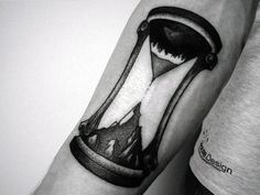 Small Simple Black Ink Mountain Top Hourglass Mens Tattoo On Arm