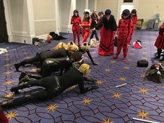 Cosplayers. Chat Noirs and a laser pointer.  (Miraculous Ladybug)