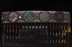 Antique tortoiseshell comb with very fine mother of pearl inlay