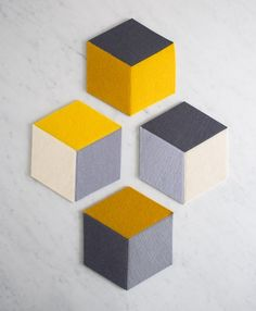 Tumbling Blocks Coasters + Trivets Basically just felt and a sewing machine! Tumbling Blocks Coasters + Trivets Basically just felt and a sewing machine! The Coasters, Felt Coasters, Felt Crafts, Diy And Crafts, Diy Tableau, Sewing Projects, Craft Projects, Knitting Projects, Sewing Hacks