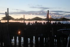 Group Sunset Celebration, Sunset Pier Bar. Photo by Kevin O'Connor, 2014.