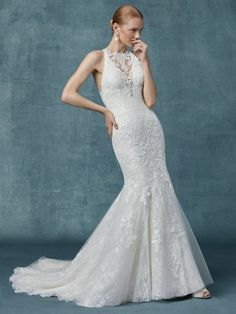 14aa17902cb0 Finished with covered buttons over zipper closure. Janene's Bridal Boutique  · Maggie Sottero