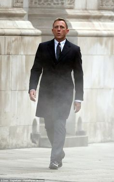 The name's Bond: Daniel smartedned up in a suit to film on Whitehall road earlier  in the ...