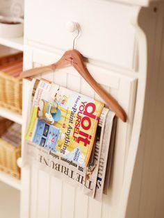 Create a magazine holder using a coat hanger! Image via www.bhg.com