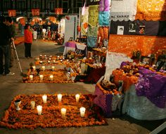 """Así sabe México: Altares de Muertos - the dead altars and offerings contain elements that could attract the person for who it is made the offering, whether their favorite food, photos, a bad habit which would have had (usually linked to gustatory pleasure, as cigarettes or alcohol) and any element that would bring them """"home"""" even for one night."""
