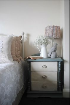 Shabby chic bedroom. Nightstand (bedside table, cabinet) painted in Annie Sloan's Duck Egg Blue and Old White