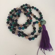completing the absolute unique custom order for meditating for the Sixth Chakra /The Third eye Chakra. It's a beautiful and powerful combination of Blue Tigers eye, Chyrscolla, Mookaite Jasper, Rainbow Moonstone, Black Obsidian and African Turquoise.