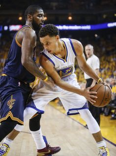 Golden State Warriors' Stephen Curry tries to get past Cleveland Cavaliers' Kyrie Irving in the first period during Game 1 of The NBA Finals on Thursday, June 4, 2015 in Oakland, Calif. Photo: Scott Strazzante, The Chronicle