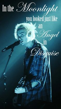 """In the moonlight, you looked just like an angel in disguise.""  Michael Clifford Lockscreen feat lyrics from Wrapped around your finger by 5SOS"
