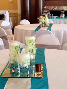 """Combination of Centerpieces: Half Cylinder Trios and the other Half 5"""" Cylinders with varieties if Flowers."""