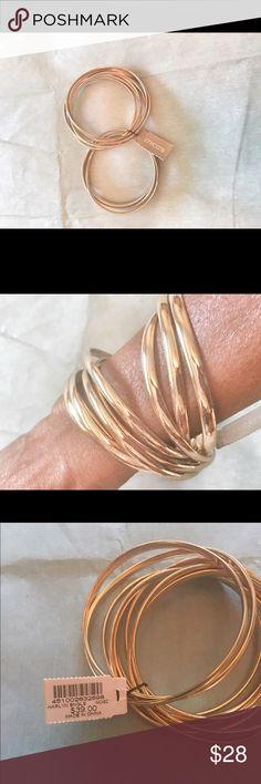 Chico's gold tone 9-bangle set Like now. Description coming. Chico's Jewelry Bracelets