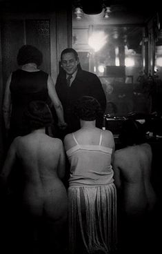 """Brassaï (Gyula Halász)   At «Suzy's», rue Gregoire-Tours. 1932.  Photograph of the staff of a Latin Quarter bordello called """"Suzy"""". """"Suzy,"""" says Brassai, """"was one of the discreet houses that guaranteed the anonymity of its guests. Even priests got in and out without being recognized."""""""