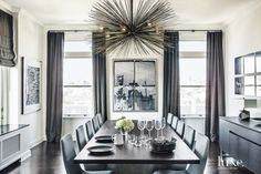 Formal, modern dining space with gorgeous details and glamorous chandelier