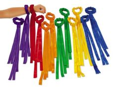 """Rainbow Wrist Ribbons by Lakeshore Learning Materials. $19.99. Children can't wait to get moving with our delightful wrist ribbons! The stretchy satin ribbons slide right onto kids' wrists-so their hands are free to dance, wave, clap and more! You get a supply of 12 ribbons in six bright colors; the machine-washable ribbon dancers are 15 1/2"""" long."""