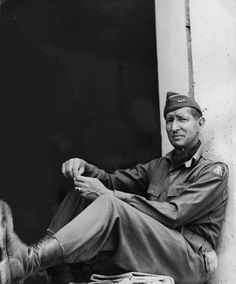 The commander of the 5th U.S.Army, Lieutenant General Mark Clark (1896-1984) takes a break sitting on the windowsill of a house in liberated Rome, summer 1944.Clark has been heavily criticised for ignoring the orders of his superior officer, General Alexander, and and is to blame for the escape of the German 10th Army which he let slip away in his pursuit of being the first to enter Rome - a strategically unimportant city.