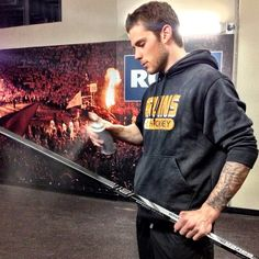 5/6/13 Tyler Seguin gives his stick a spray outside the locker room before game 3 of the playoffs at Toronto.
