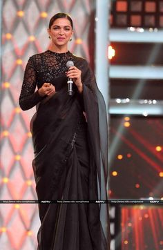 Deepika Padukone attended two events in Mumbai on Saturday night - Mumbai Police's annual event Umang and celebrated 25 years of a channel. She wore a black Sabyasachi sari for the events.