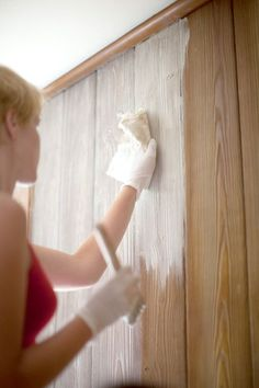 How to whitewash wood paneling - Mix a solution of equal parts white paint and water. Cover a small section of the paneling at a time with the whitewash. Wipe off the excess paint with scraps of flannel sheet. Allow the room to dry completely. Painting Wood Paneling, Cover Wood Paneling, Wood Paneling Decor, Painted Paneling Walls, Wood Panel Walls, Bedroom Wall, Wood Furniture, Painting Furniture, Furniture Makeover