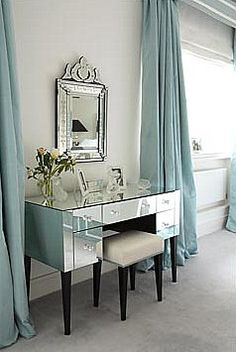 Kendall really liked this light blue wall with the long drapes....also she likes the mirror and the vanity :)mirrored furniture from House and Leisure
