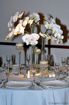 dd280974b1 Superior Florist – Centerpieces  Three tower glass vases with cascading  Phalaenopsis orchids